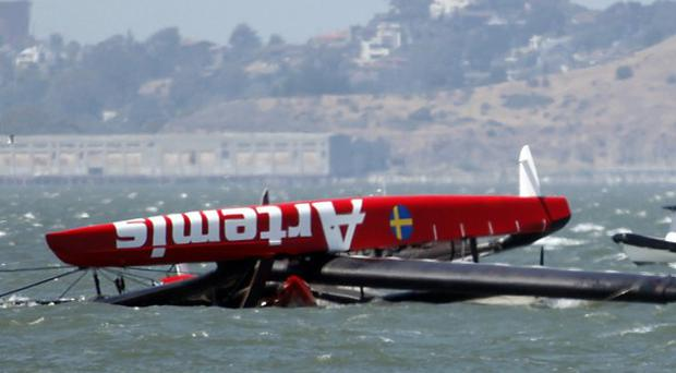 The overturned Artemis Racing AC72 catamaran in San Francisco Bay (AP/San Jose Mercury News, Karl Mondon)