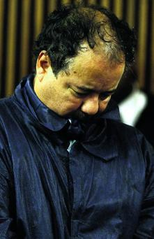 Ariel Castro stands with his head down during his arraignment on kidnapping and rape charges on May 9