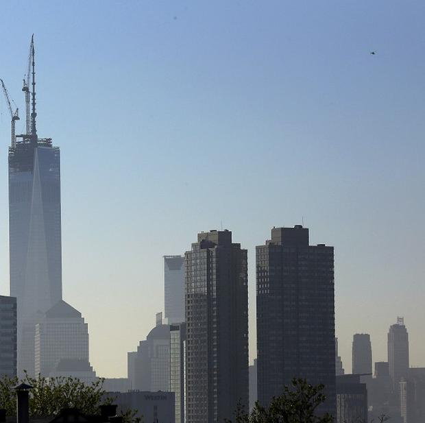 One World Trade Centrer stands at its full height above the New York City skyline after a 408-ft spire was set into place at the top of the structure (AP)