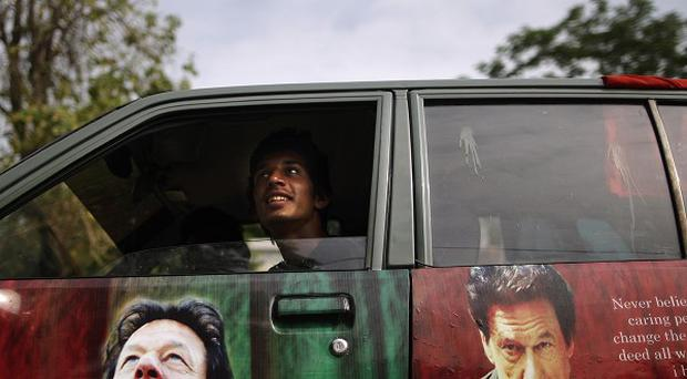 A Pakistani supporter of former cricket star-turned-politician Imran Khan in Islamabad, Pakistan (AP/Muhammed Muheisen)