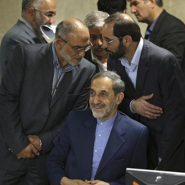Former Iranian foreign minister Ali Akbar Velayati, seated, a senior advisor to supreme leader Ayatollah Ali Khamenei, smiles as he registers his candidacy for the upcoming presidential election (AP)