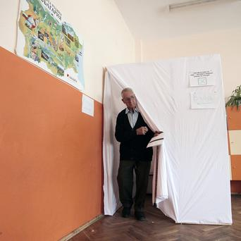 A Bulgarian man casts his vote for parliamentary elections in Sofia (AP)
