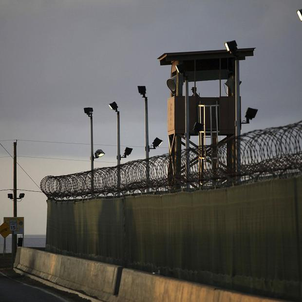 A guard looks out from a tower at the detention facility of Guantanamo Bay where detainee Musa'ab Omar A Madhwani says he feels abandoned (AP)