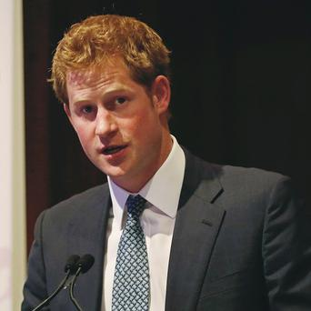 Prince Harry addresses the American Friends of The Royal Foundation dinner in New York (AP)