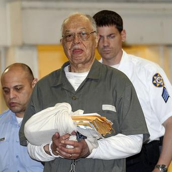 Dr Kermit Gosnell is escorted to a police van after being convicted of first-degree murder in the deaths of three babies (AP)