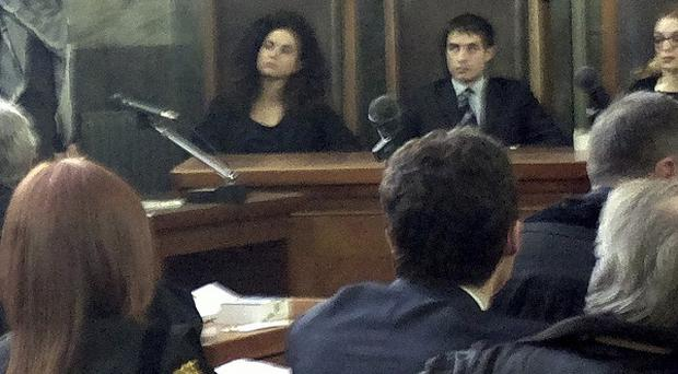 Karima el-Mahroug, known as Ruby, the woman at the centre of a sex scandal involving ex-Premier Silvio Berlusconi, gives evidence in a Milan court (AP)