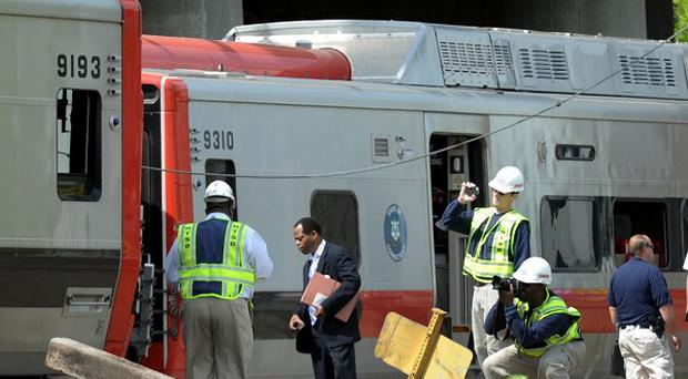 Investigators at the scene of the train collision in Bridgeport, Connecticut (AP/The Connecticut Post, Cathy Zuraw)
