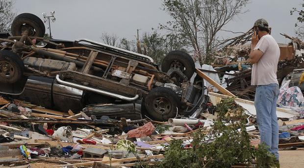 John Warner surveys the damage to a home destroyed in Sunday's tornado, near Shawnee (AP)