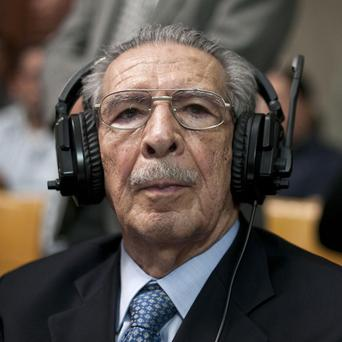 Jose Efrain Rios Montt wears headphones as he listens to the verdict in his genocide trial in Guatemala City (AP/Luis Soto)