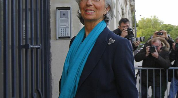 International Monetary Fund head Christine Lagarde arrives at a Paris court to face questions over a financial deal (AP)