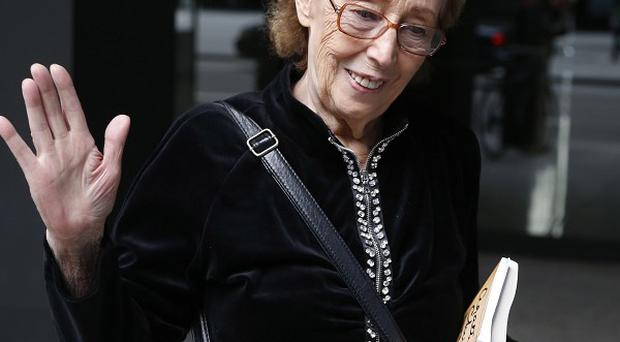 Jacqueline Goldberg leaves federal court after a jury returned with a finding in Donald Trump's favour in her civil case (AP)