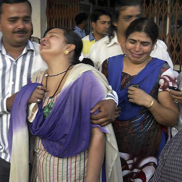 Relatives of those injured in a Maoist rebel attack cry outside a government hospital in Raipur, India (AP)