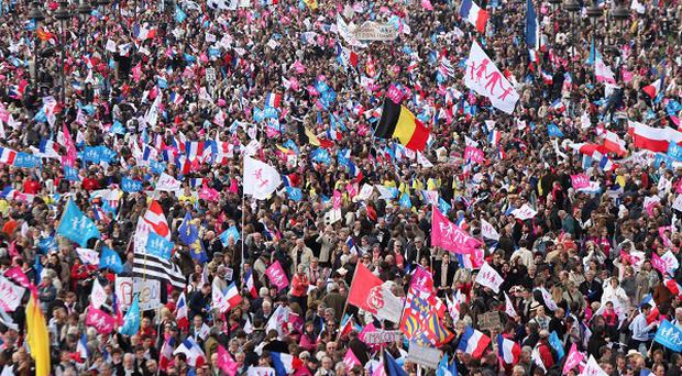 Anti-gay marriage protesters gather during a demonstation against French president Francois Hollande's social reform, in Paris (AP)