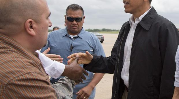 US President Barack Obama arrives at Tinker Air Force Base in Midwest City, Oklahoma (AP)