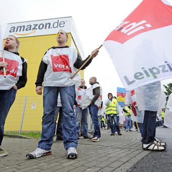 Employees of online retailer Amazon are on strike in front of the company's branch in Leipzig (AP)
