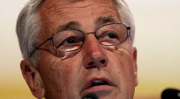 US defence secretary Chuck Hagel delivers his keynote speech at a security conference in Singapore (AP)