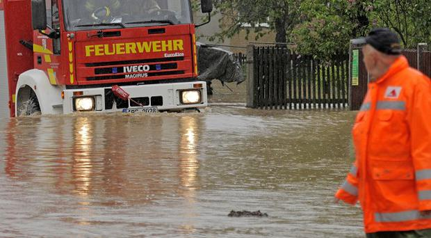 A fire engine drives through a flooded area near Saara, central Germany (AP)
