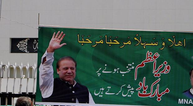 A banner with the photo of Pakistan's new Prime Minister Nawaz Sharif is displayed near the National Assembly building in Islamabad (AP)