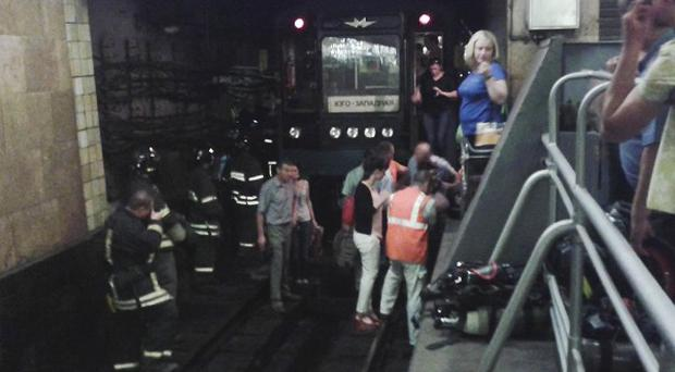 People leave a subway station in Moscow after a rush-hour fire (AP)