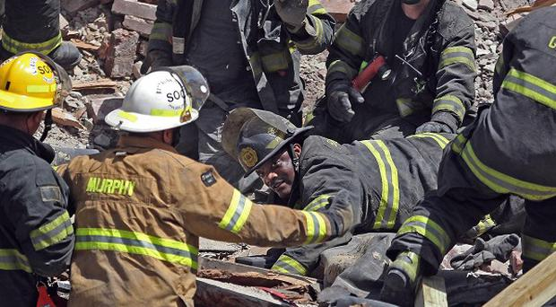 Philadelphia firefighters work in the rubble of a collapsed building in the city (AP/The Philadelphia Inquirer, Michael Bryant)