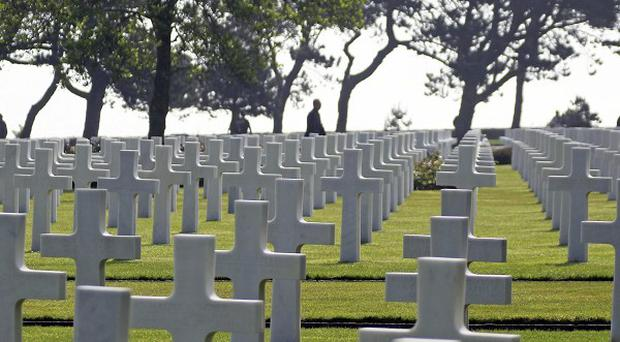 Visitors walk among the 9,387 tombs at the Colleville American military cemetery, in Colleville sur Mer (AP)