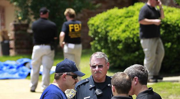 Authorities search a residence in New Boston, Texas, in connection with an investigation into ricin-laced letters (AP/Texarkana Gazette, Evan Lewis)