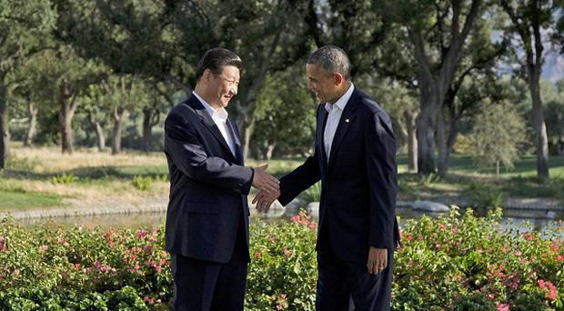 Barack Obama shakes hands with Chinese President Xi Jinping in California (AP/Evan Vucci)