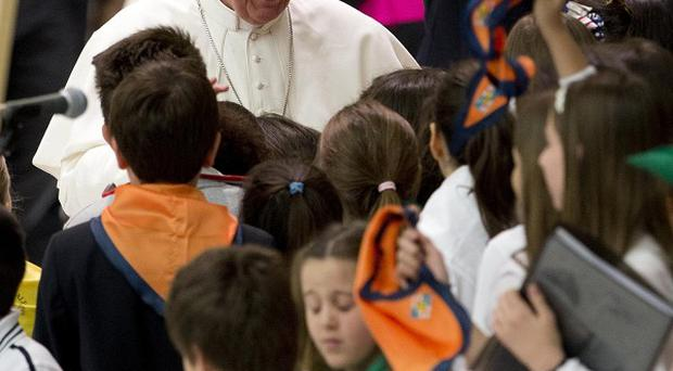 Pope Francis greets youths during an audience with students of Jesuit schools in Italy and Albania, at the Vatican (AP/Andrew Medichini)