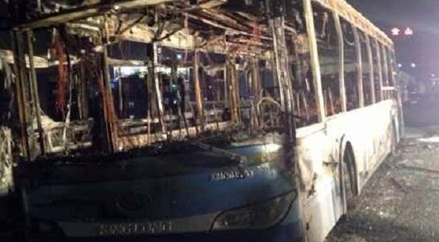 The wreckage of an express bus that burst into flames in Xiamen, China, killing 47 people (AP/Xinhua)