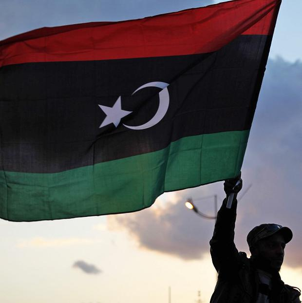 Seven people were killed in clashes between protesters and former rebels in Benghazi, Libya (AP)