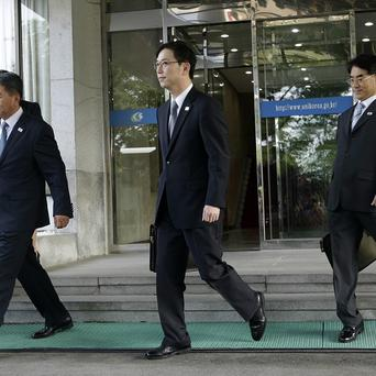 Chun Hae-sung, centre, the head of South Korea's working-level delegation, leaves for Panmunjom (AP/Lee Jin-man)