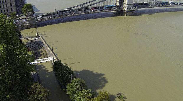The flooded River Danube with the Chain Bridge in the foreground in Budapest, Hungary (AP/MTI, Imre Kmetz)