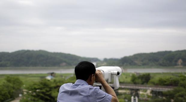A South Kroean looks at North Korea near the border village of Panmunjom (AP)