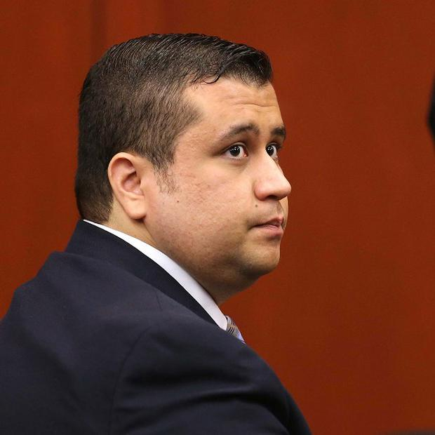 George Zimmerman listens to his attorneys in Seminole circuit court during jury selection for his trial, in Sanford, Florida (AP)
