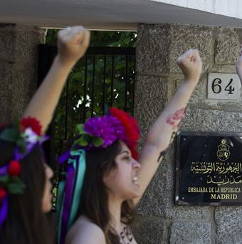Spanish activists of Femen shout for the release of fellow activists, who are imprisoned in Tunisia (AP)