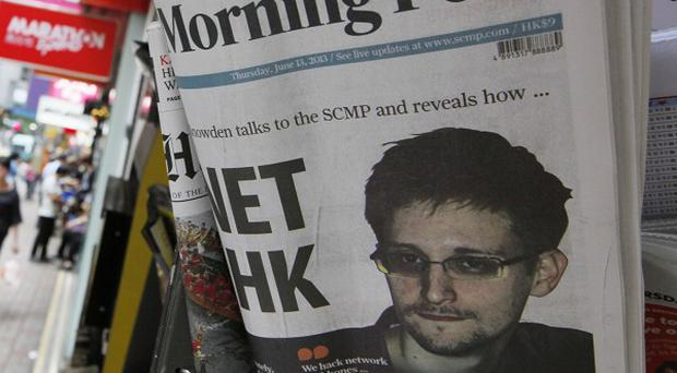 The picture of Edward Snowden is displayed on the front page of South China Morning Post at a news stand in Hong Kong (AP)