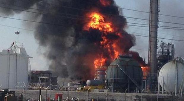 Smoke and flames rise after an explosion at The Williams Companies chemical plant in Louisiana (AP)