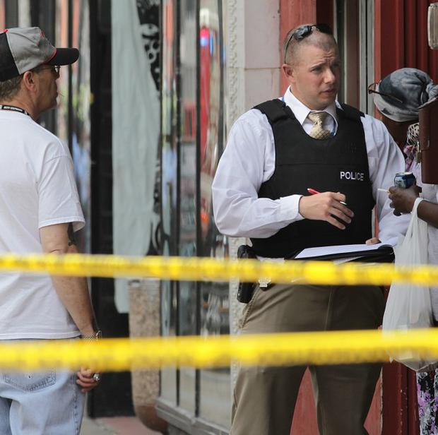 St Louis police at the scene of the shooting (AP/St Louis Post-Dispatch, Robert Cohen)