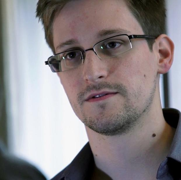 Edward Snowden is 'highly likely to be refused entry to the UK', a Home Office alert said (AP/The Guardian)