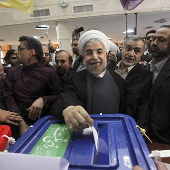 Iranian presidential candidate Hasan Rowhani, the country's former top nuclear negotiator, casts his ballot in the presidential election (AP)