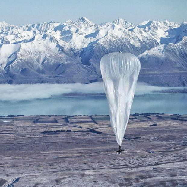 A Google balloon sails through the air with the Southern Alps mountains in the background, in Tekapo, New Zealand. (AP)