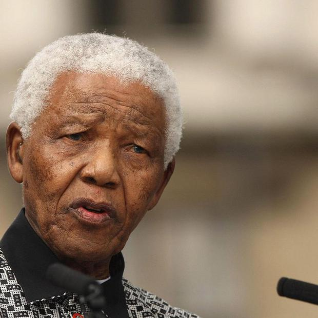 Nelson Mandela is 'continuing to improve' but remains in a serious condition in hospital
