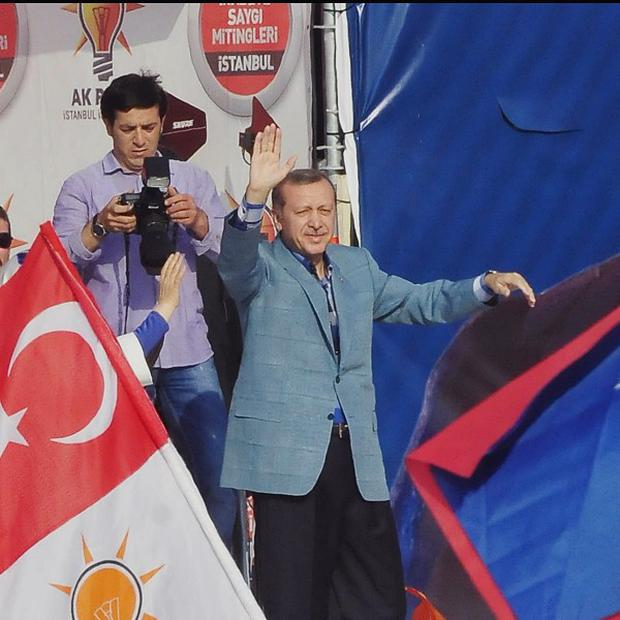 Turkish prime minister Recep Tayyip Erdogan salutes supporters (AP)