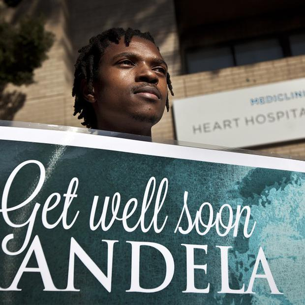 A group of wellwishers outside the Mediclinic Heart Hospital where former South African president Nelson Mandela is being treated in Pretoria (AP)
