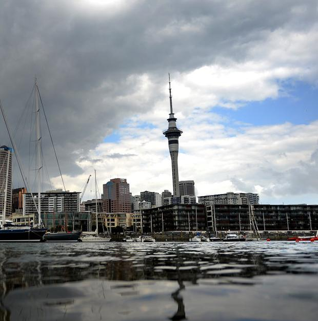 A Briton has reportedly survived a 15-storey building plunge in Auckland