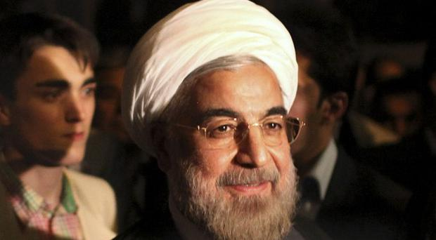 New Iranian president Hasan Rowhani has held his first news conference (AP)