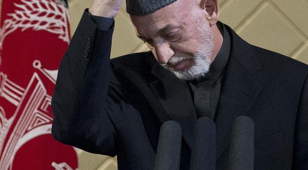 The security handover will be attended by Afghan president Hamid Karzai (AP)