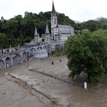 Floodwater sweeps across the Lourdes pilgrim site (AP)