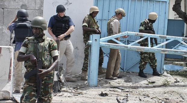 African Union peacekeepers outside the main UN compound following an attack on it in Mogadishu, Somalia (AP/Farah Abdi Warsameh)