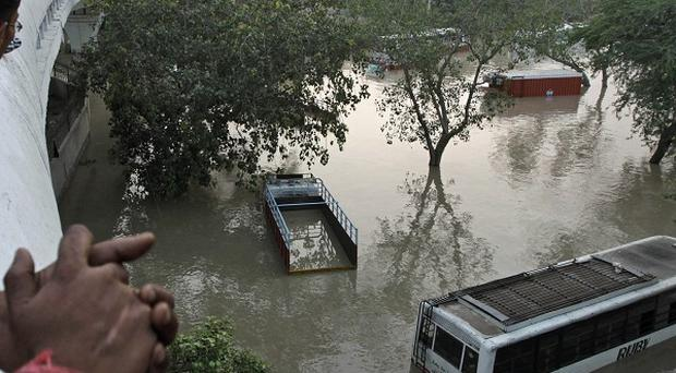 The death toll from weekend flooding in India has topped 100 and is likely to rise (AP)